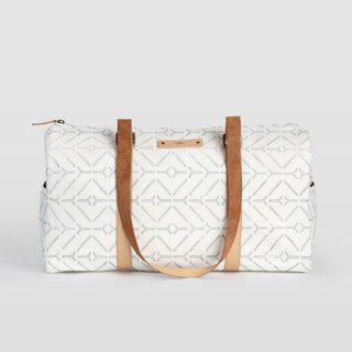 This is a white duffle bag by Carolyn Nicks called Coastal in standard.