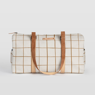 This is a brown duffle bag by Carolyn Nicks called Montauk in standard.