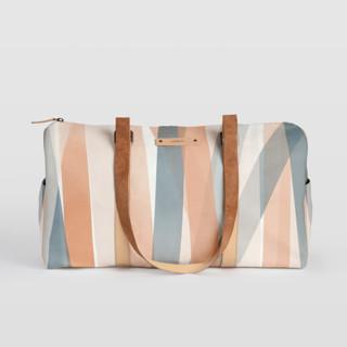 This is a blue duffle bag by Stephanie C Martinez called Pastel Beach.