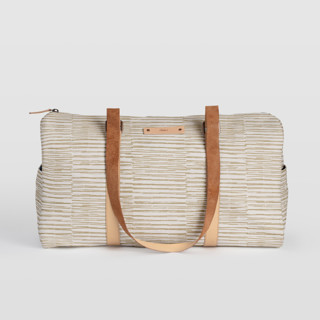 This is a brown duffle bag by Alethea and Ruth called Dashed Stripes in standard.