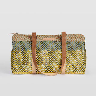 This is a yellow duffle bag by Bethania Lima called Basic in standard.