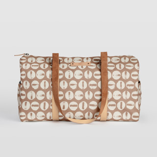 This is a brown duffle bag by Carrie ONeal called Penny Thoughts in standard.