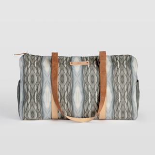 This is a brown duffle bag by Angela Simeone called Ikat Stripe in standard.
