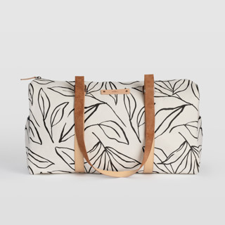 This is a black and white duffle bag by Cass Loh called ink line leaves in standard.
