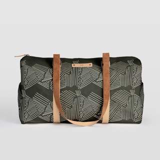 This is a black duffle bag by Deborah Velasquez called Savanna Grassland in standard.