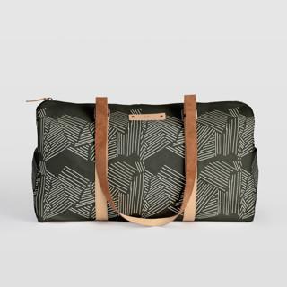 This is a black duffle bag by Deborah Velasquez called Savanna Grassland.