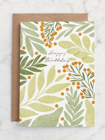 Green leaves and orange berries