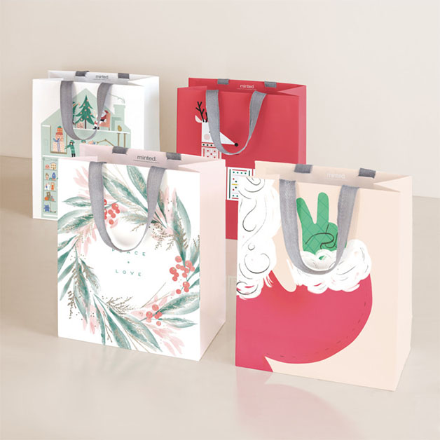 This is a red wrapping paper by Multiple Artists called Merrymakers.