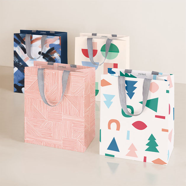 This is a blue wrapping paper by Multiple Artists called Pop Holiday in standard.