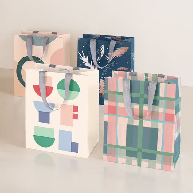 This is a pink wrapping paper by Multiple Artists called Design Lover's Holiday.