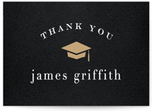 This is a black graduation tag by Hooray Creative called Graduated with standard printing on signature in sticker.