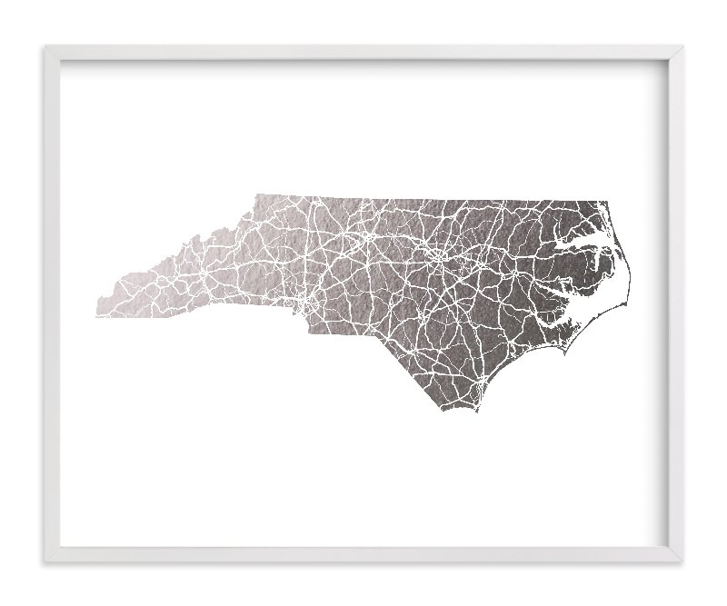 This is a silver foil stamped wall art by GeekInk Design called North Carolina Map.