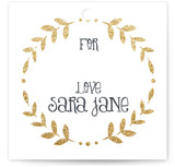 This is a gold gift tag by Erin Deegan called Glittering Monogram printing on signature.