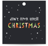 This is a black gift tag by Pixel and Hank called Don't Open Until Tag printing on signature.