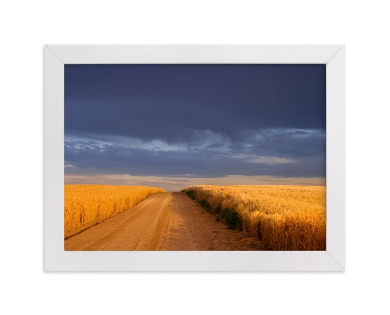 """""""Dirt Road Through a Wheat Field Under a Stormy Sky"""" - Limited Edition Art Print by Kathy Van Torne in beautiful frame options and a variety of sizes."""