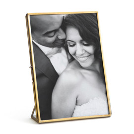 This is a gold picture frame by Minted called Brass.