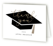 This is a black graduation thank you card by Stacey Meacham called Caps Off with foil-pressed printing on strathmore in standard.