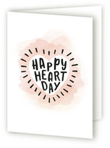 This is a pink greeting card by Hooray Creative called Happy Heart Day with standard printing on signature.