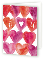This is a red greeting card by Corinne Haig Designs called I Heart You with standard printing on signature.