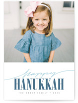 This is a blue hanukkah card by Kann Orasie called Hand-scripted Happy Hanukkah printing on smooth signature in standard.