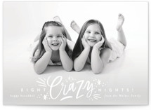 This is a white hanukkah card by Alethea and Ruth called Eight Crazy Nights printing on smooth signature in standard.