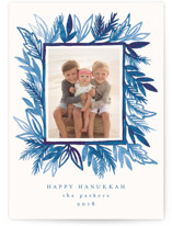 This is a blue hanukkah card by Katharine Watson called Painted Pine Leaves printing on smooth signature in standard.