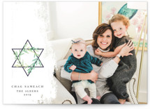 This is a green hanukkah card by Ana de Sousa called Star of David printing on smooth signature in standard.
