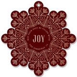 This is a red holiday card ornament by Ana de Sousa called Christmas snowflake with foil-pressed printing on signature in ornament.