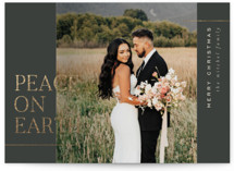 This is a green foil stamped holiday card by Pixel and Hank called Peace on Earth with foil-pressed printing on smooth signature in standard.
