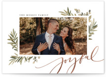This is a green foil stamped holiday card by Wildfield Paper Co. called Joyful Script with foil-pressed printing on smooth signature in standard.