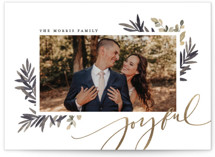 This is a black foil stamped holiday card by Wildfield Paper Co. called Joyful Script with foil-pressed printing on smooth signature in standard.