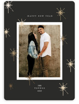This is a black foil stamped holiday card by Geraldine Sales called New year sparks with foil-pressed printing on smooth signature in standard.