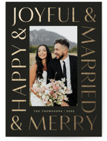 This is a black foil stamped holiday card by Louise Kay called Joyfully Married with foil-pressed printing on smooth signature in standard.