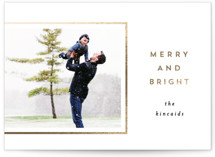 This is a black foil stamped holiday card by AK Graphics called Minimally Merry with foil-pressed printing on smooth signature in standard.