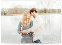 This is a white gloss press holiday card by Wildfield Paper Co. called Snow Flurries with gloss-press printing on smooth signature in standard.
