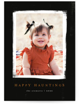 This is a black halloween party invitations card by Angela Garrick called happy hauntings printing on smooth signature in standard.
