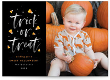 This is a black halloween party invitations card by Ana Sharpe called A Sweet Halloween printing on smooth signature in standard.