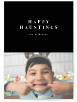 This is a black halloween party invitations card by Angela Garrick called happy hauntings minimal printing on smooth signature in standard.