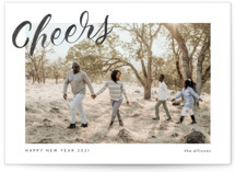 This is a white new year photo card by Ashley DeMeyere called Simple Cheers with standard printing on smooth signature in standard.