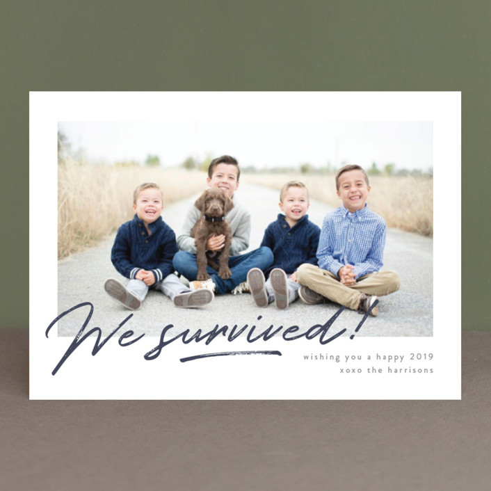 """""""We Survived"""" - Funny New Year Photo Cards in Snow by Robert and Stella."""