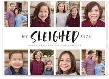 This is a black new year photo card by Lori Wemple called Sleighed with standard printing on smooth signature in standard.
