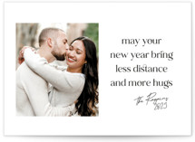 This is a white new year photo card by Leah Ragain called let there be hugs with standard printing on recycled smooth signature in standard.