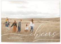 This is a white new year photo card by Erin Deegan called scripted cheers with standard printing on smooth signature in standard.