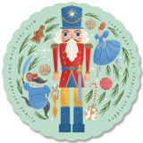 This is a blue holiday card ornament by Grae called Nutcracker Ornament with standard printing on signature in ornament.