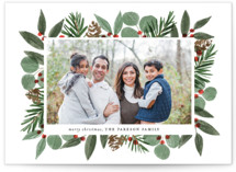 This is a white christmas postcard by Brooke Chandler called Festive Holiday Foliage with standard printing on signature in postcard.