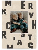 This is a beige christmas postcard by Sumak Studio called christmas typography with standard printing on signature in postcard.