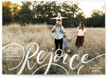 This is a white christmas postcard by Pink House Press called Rejoice! with standard printing on signature in postcard.