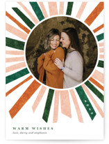 This is a orange christmas postcard by Carrie Moradi called Cheery Burst with standard printing on signature in postcard.