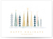 This is a white christmas postcard by Laura Mitchell called Happy Holidays with standard printing on signature in postcard.