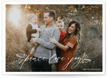 This is a white christmas postcard by Palm Bridal called Peace, Love & Joy with standard printing on signature in postcard.